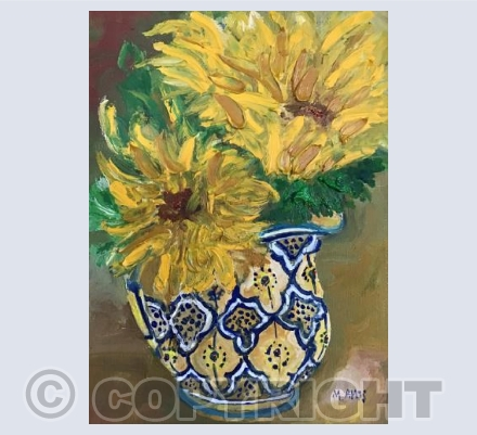 Sunflowers in a patterned jug