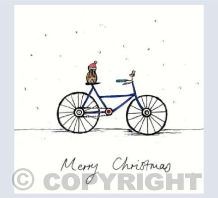 Christmas bunny on a bike