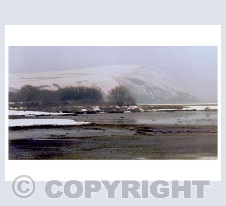 Dinas Head under a mantle of snow.